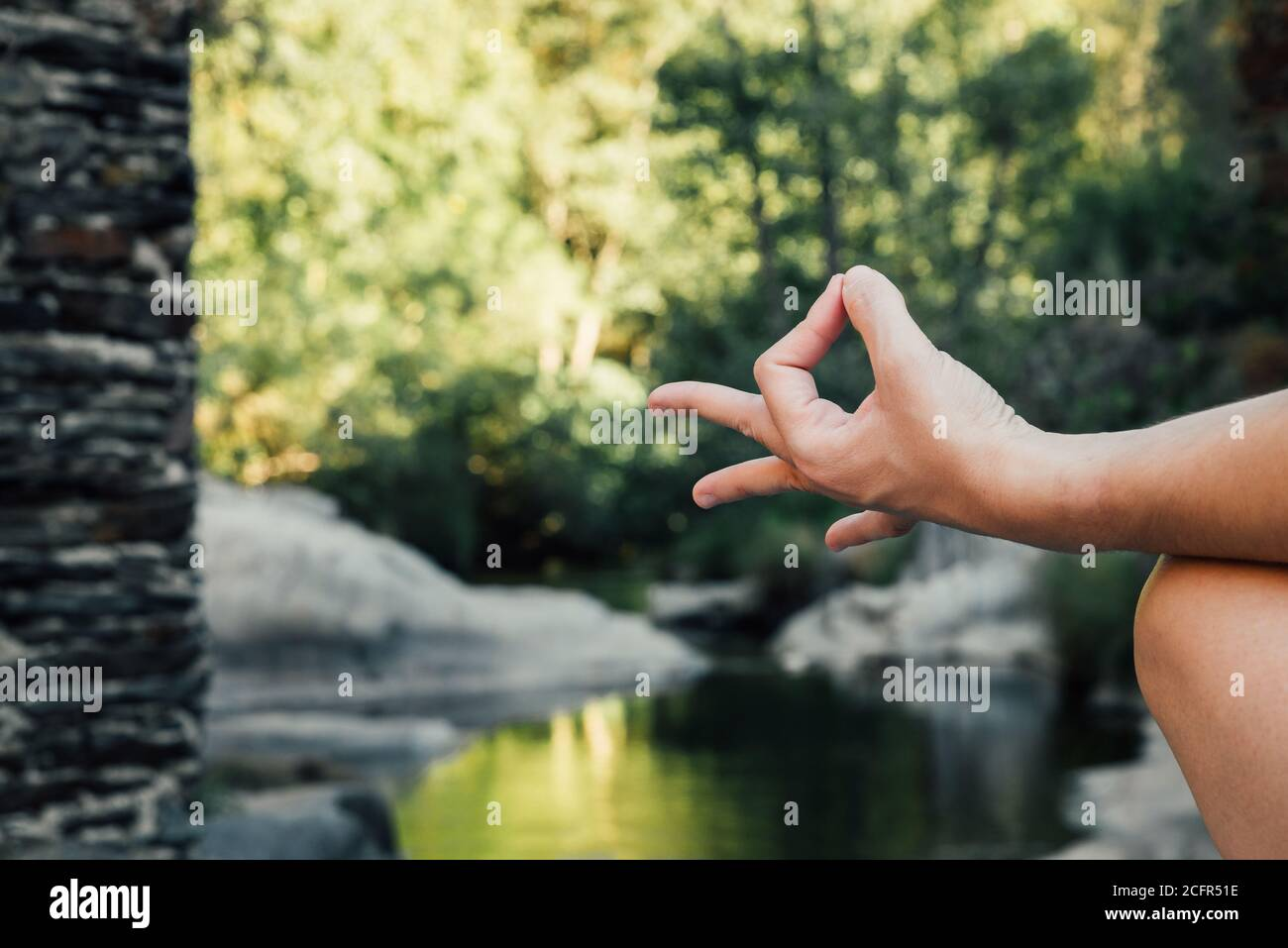 woman's hand doing a mudra in nature Stock Photo