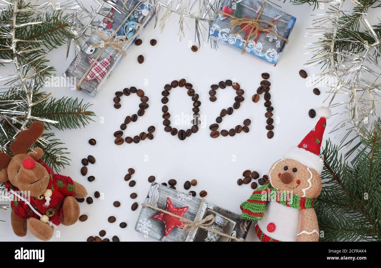 Christmas Day Logo 2021 New Year Background With A Christmas Tree Garland Gifts And Toys Inscription 2021 Made Of Coffee Beans Stock Photo Alamy