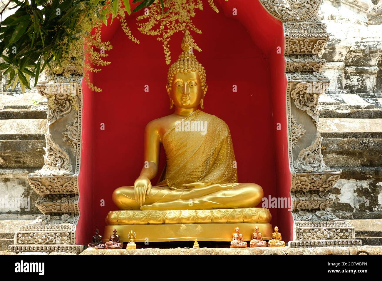 Chiang Mai Thailand - Golden Buddha statue in Temple Wat Buppharam Stock Photo