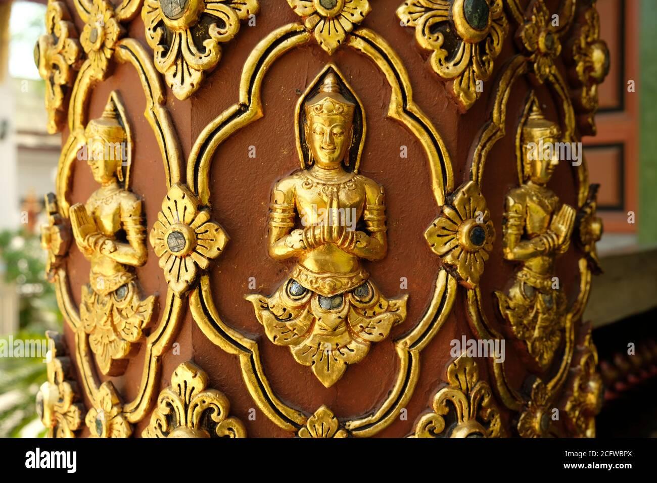 Chiang Mai Thailand - Pillar with golden Buddha in Temple Wat Buppharam Stock Photo