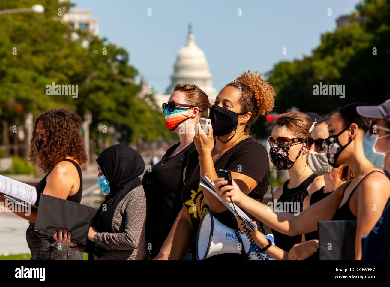 Washington, DC, USA, September 7, 2020. Pictured: Members of Songrise and the Justice Choir of DC sing during Let Freedom Sing, with the United States Capitol in the background. Let Freedom Sing was a community-building protest and voter registration event by the Freedom Day Foundation and Head Count. Credit: Allison C Bailey/Alamy Credit: Allison Bailey/Alamy Live News Stock Photo