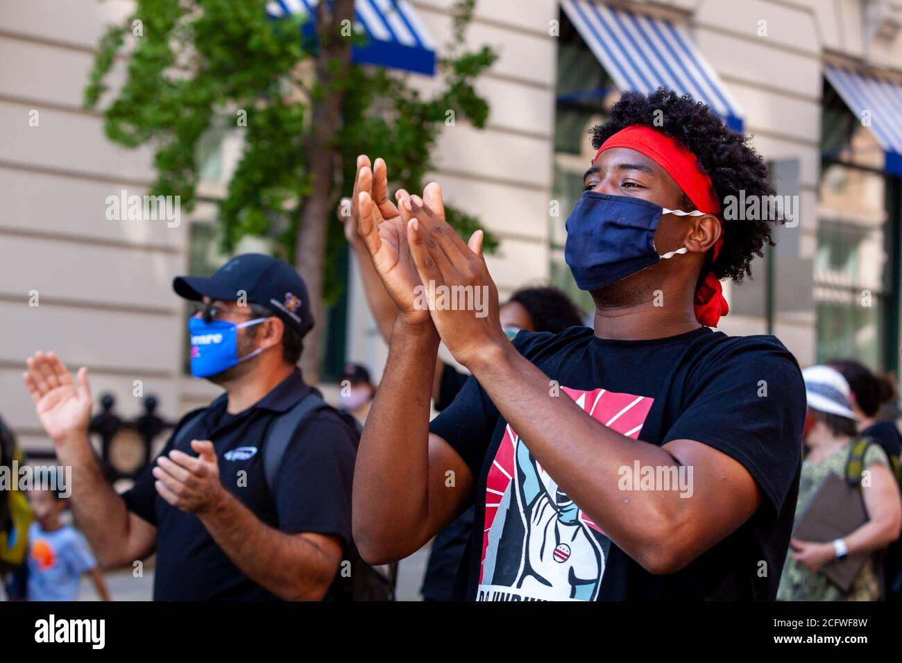 Washington, DC, USA, September 7, 2020. Pictured: Protesters clap and keep the beat as they sing during the Let Freedom Sing March en route to Freedom Plaza. Let Freedom Sing was a community-building protest and voter registration event by the Freedom Day Foundation and Head Count. Credit: Allison C Bailey Credit: Allison Bailey/Alamy Live News Stock Photo