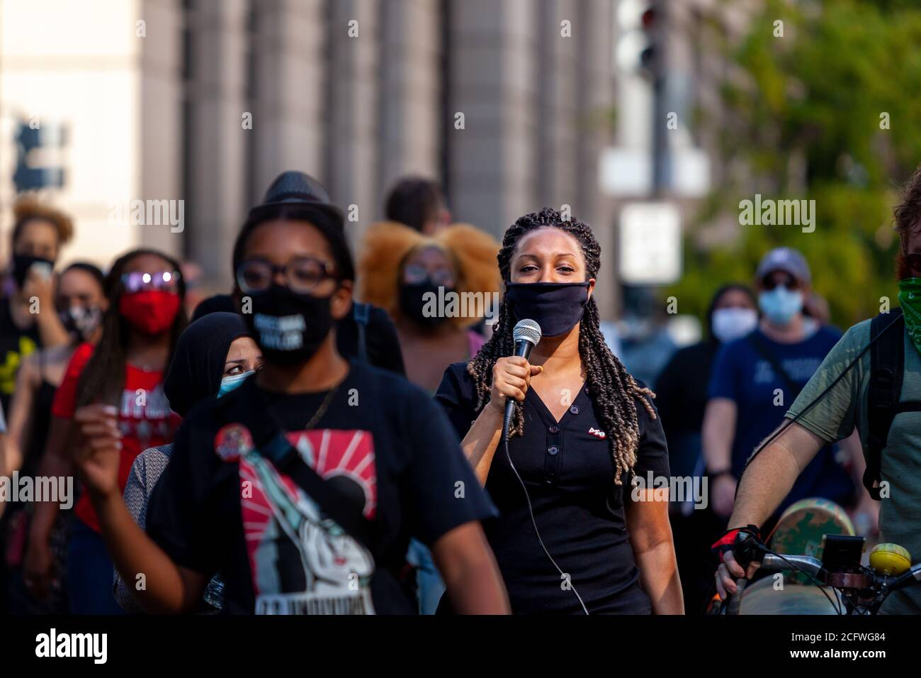 Washington, DC, USA, September 7, 2020. Pictured: A protester leads the crowd in singing as they walk down 14th Street en route to Freedom Plaza during Let Freedom Sing, a community-building protest and voter registration event by the Freedom Day Foundation and Head Count. Credit: Allison C Bailey/Alamy Credit: Allison Bailey/Alamy Live News Stock Photo