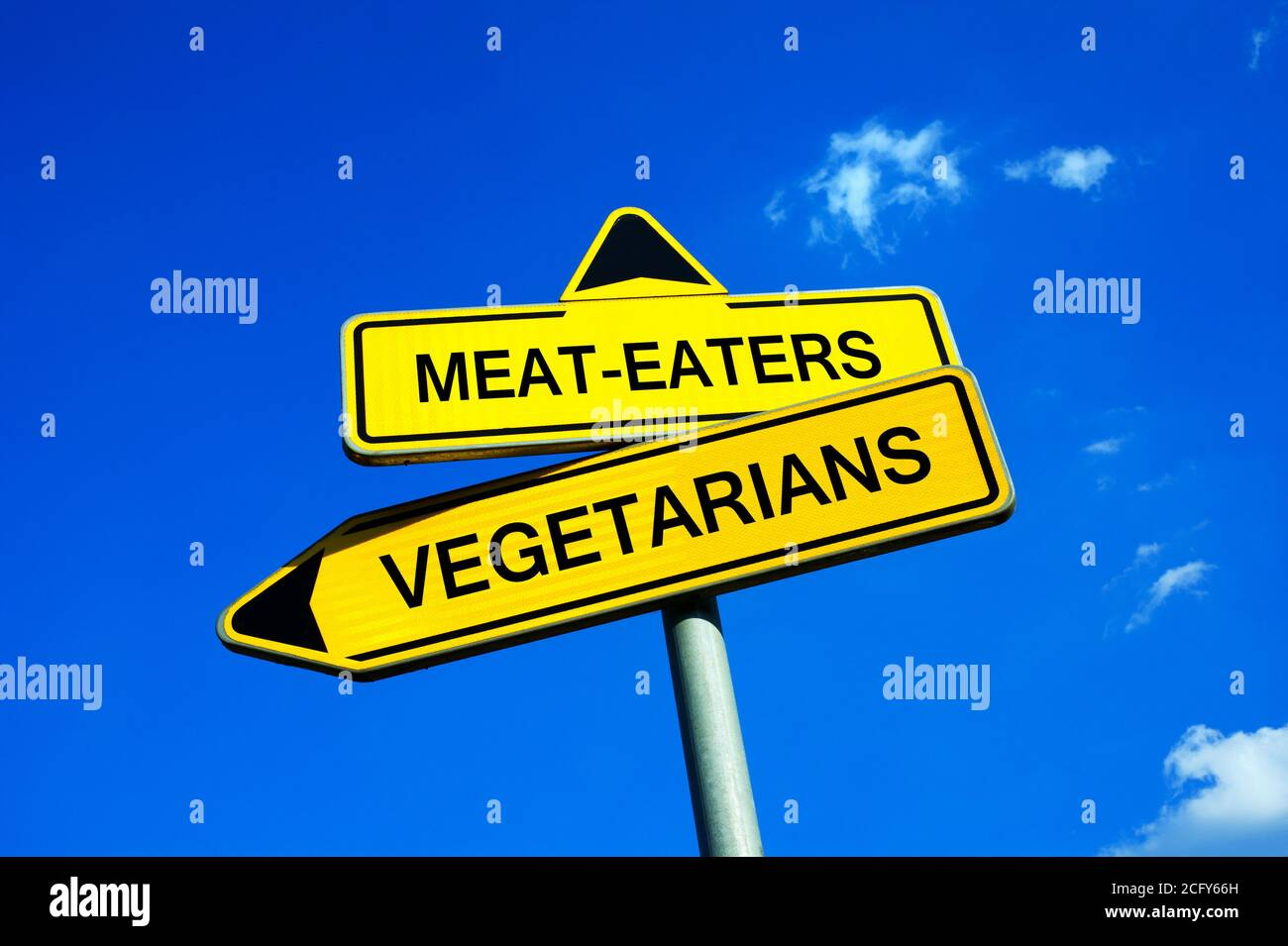Meat-eaters on Vegetarians - Traffic sign with two options. Decision to not kill animals and eat meat. Question of nutrition, health and ethics Stock Photo