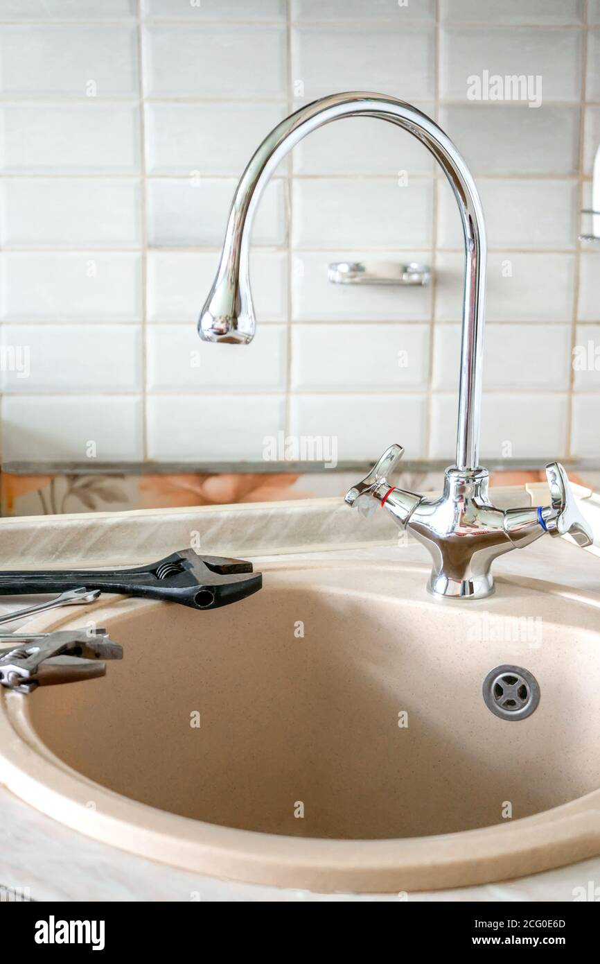 Replacing The Old Kitchen Faucet In The Kitchen Tools Lie On The Edge Of The Sink Stock Photo Alamy
