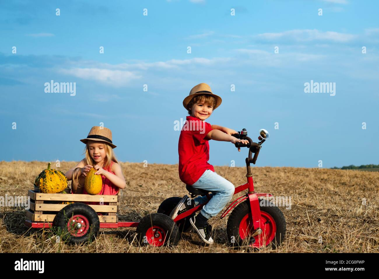Positive little girl and boy. Beautiful fun day for cute friends in nature. Little girl and boy enjoy life and nature. Little cute kids is smiling Stock Photo
