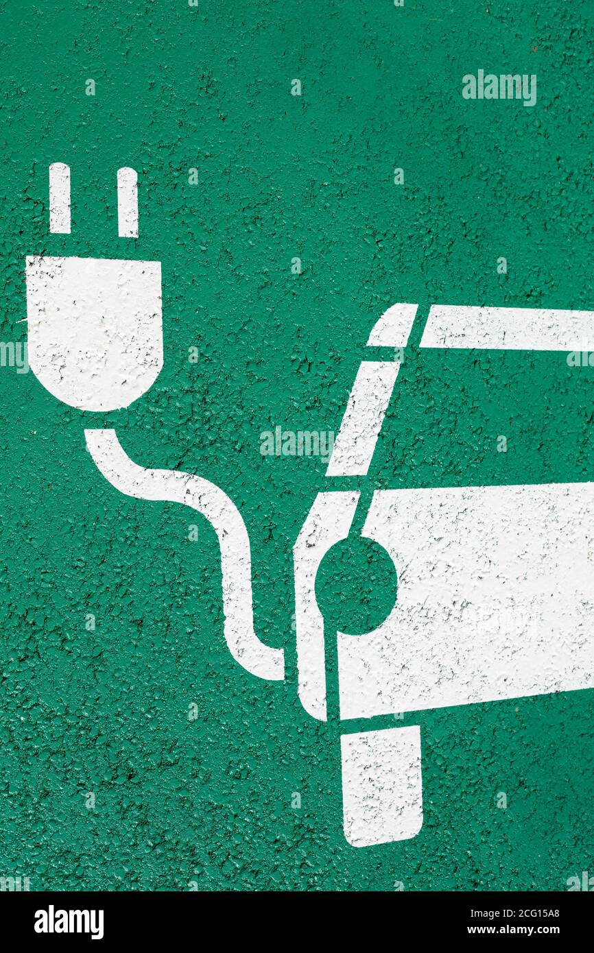 Parking symbol on the street for electric cars being charged Stock Photo