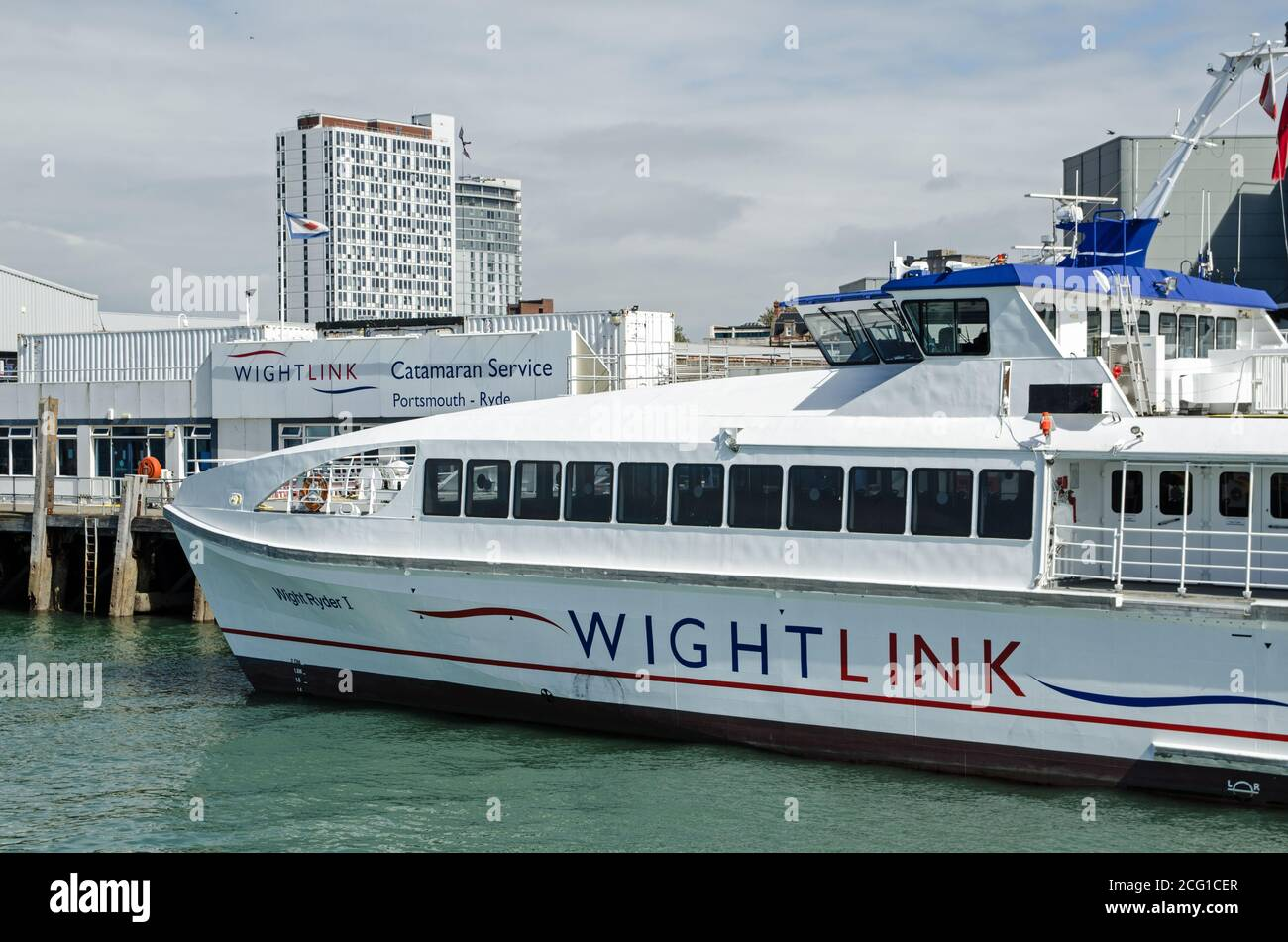Portsmouth, UK - September 8, 2020: One of the Wightlink passenger catamaran ferries docked at the Portsmouth Harbour terminal on a sunny afternoon on Stock Photo
