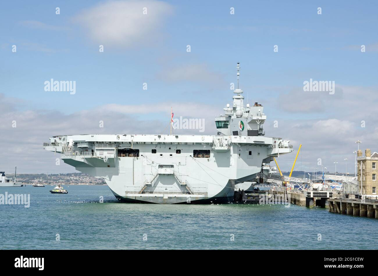 Stern of the massive Queen Elizabeth Aircraft Carrier docked at Portsmouth Harbour, Hampshire.  The Royal Navy ship is the largest in the fleet. Stock Photo