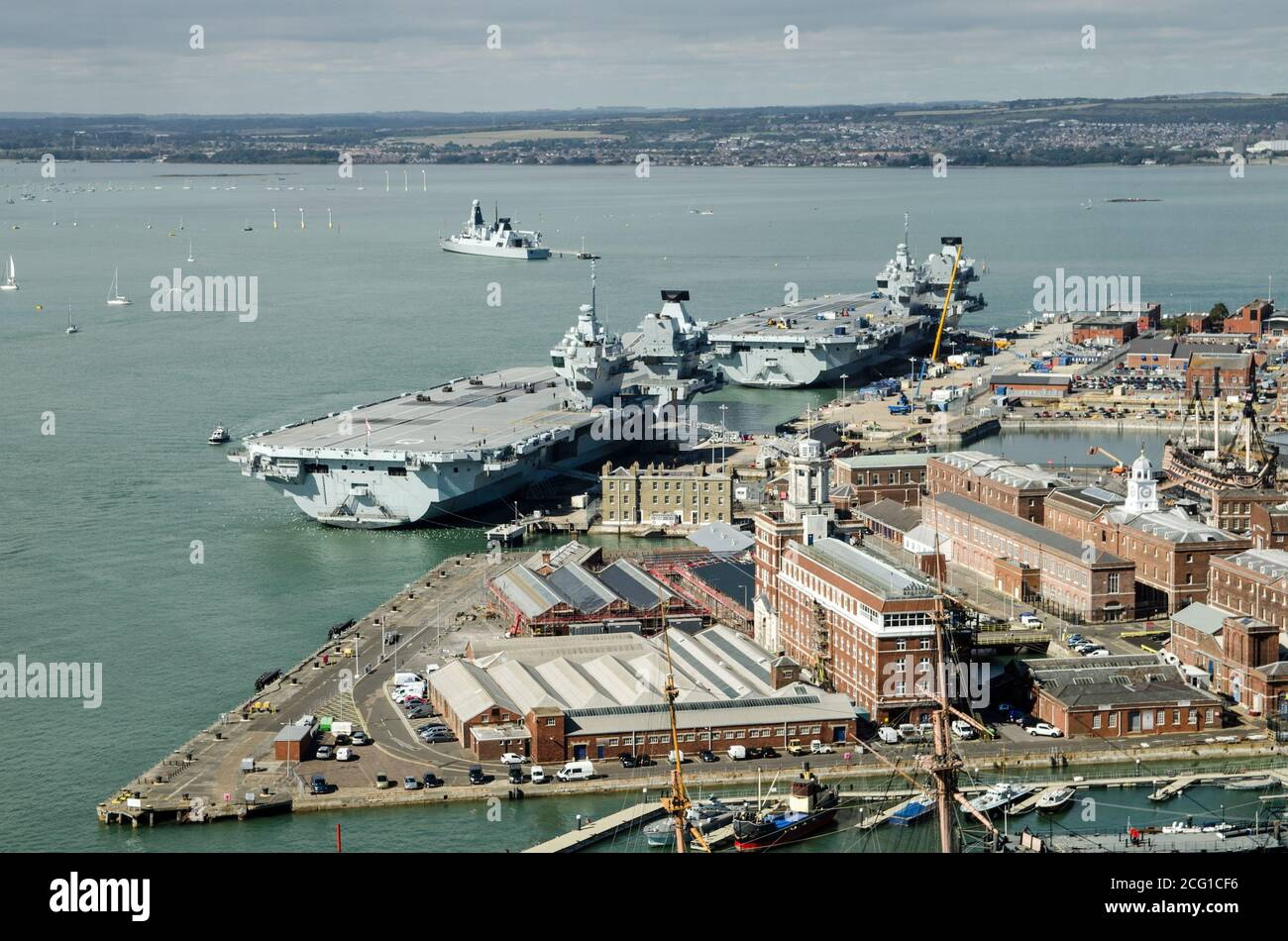 Aerial view of the two largest ships in the Royal Navy, the aircraft carriers Queen Elizabeth and the Prince of Wales moored beside each other in Port Stock Photo