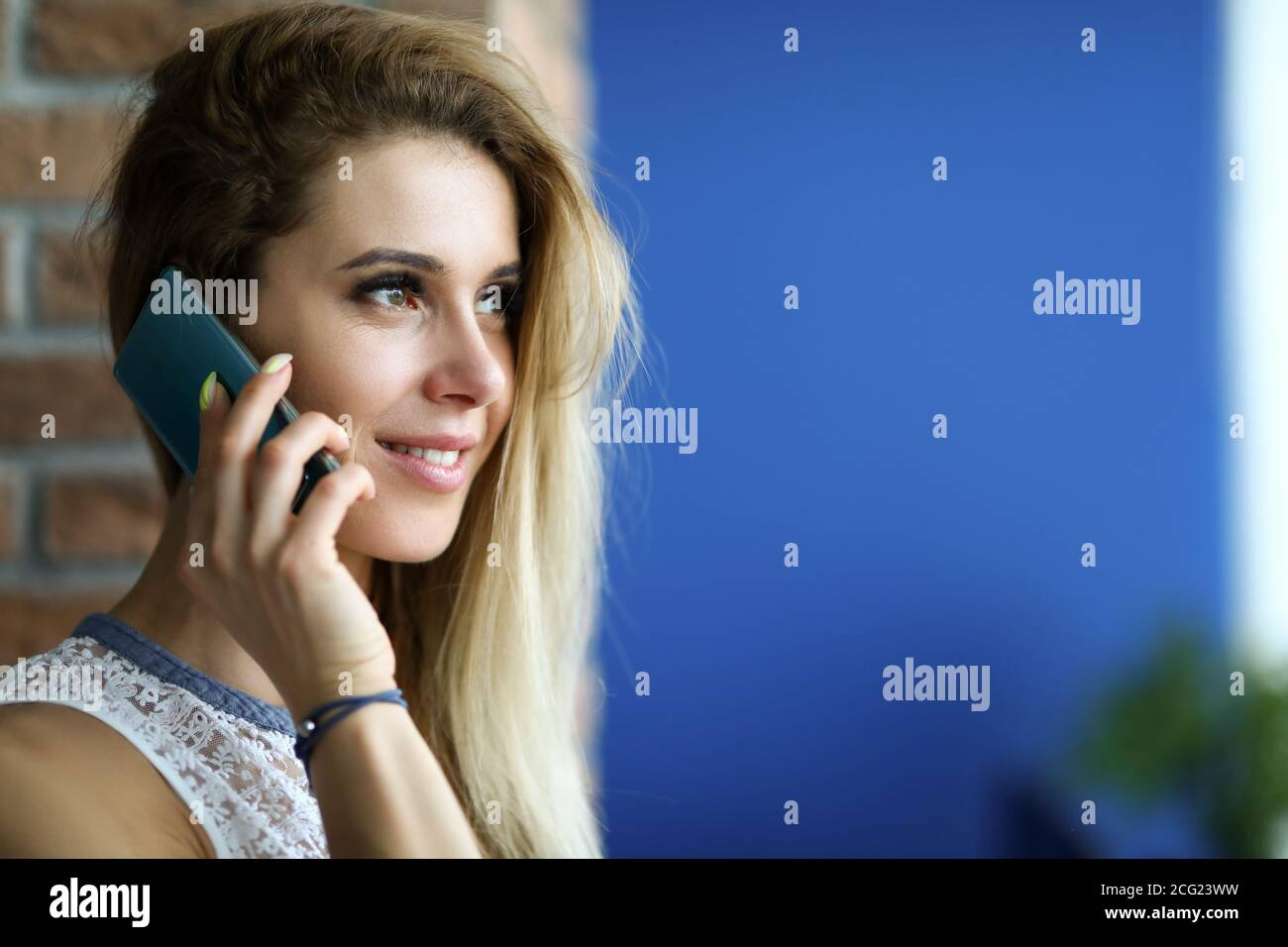 Attractive female posing indoors Stock Photo