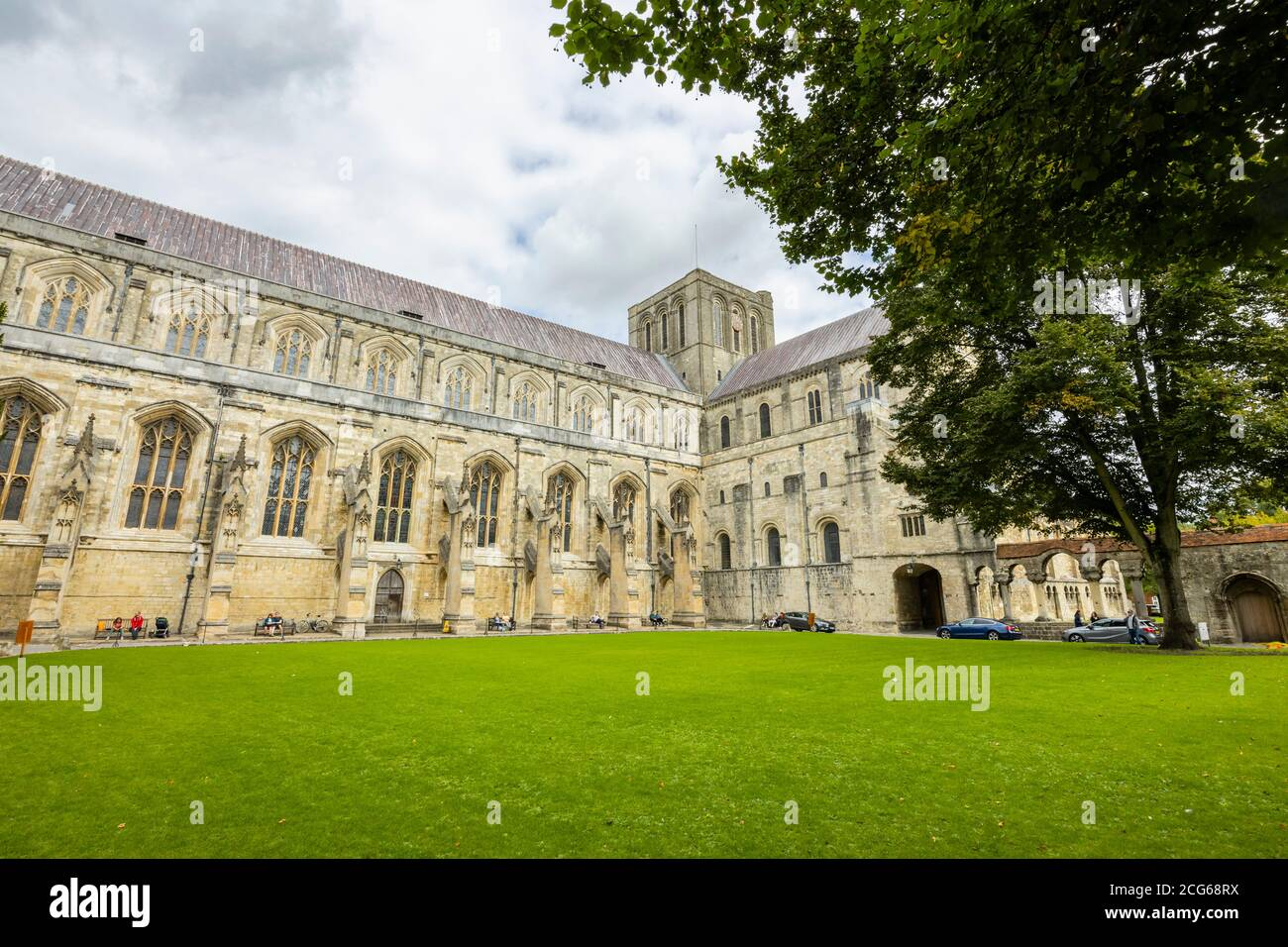 Flying buttresses and stonework on the south side of the exterior of Winchester Cathedral in Winchester, Hampshire, south England Stock Photo