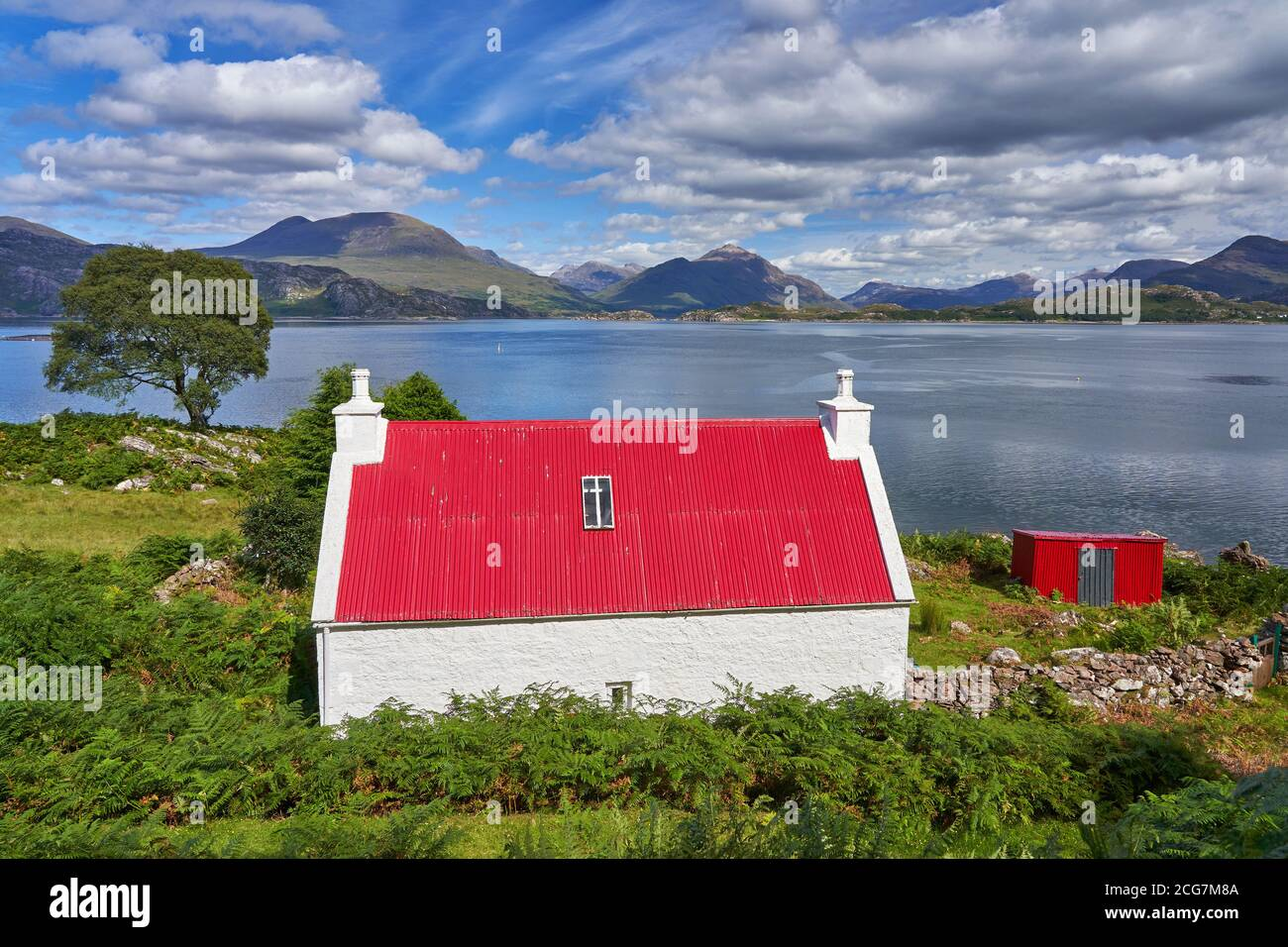 North Coast 500 route near Ardheslaig Applecross Peninsula with Torridon mountains in background Wester Ross Scotland Stock Photo