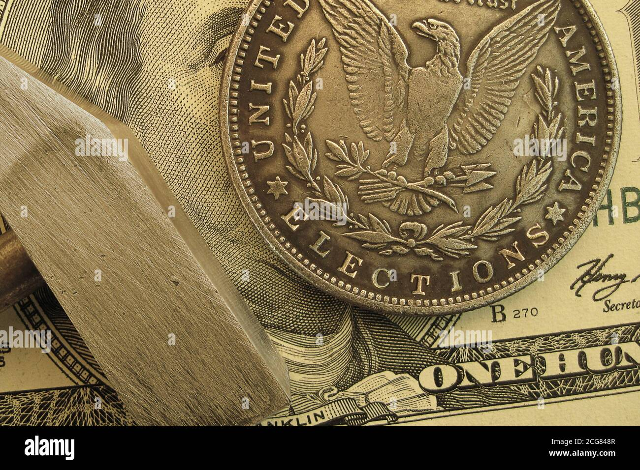An American dollar coin with a graving text Elections. Voting campaign concept Stock Photo