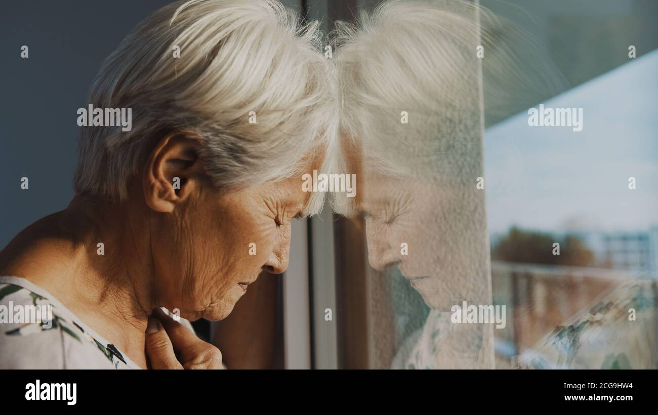hopeless elderly woman, feeling loneliness during the lockdown. Vulnerable group and mental health issues. High quality photo Stock Photo