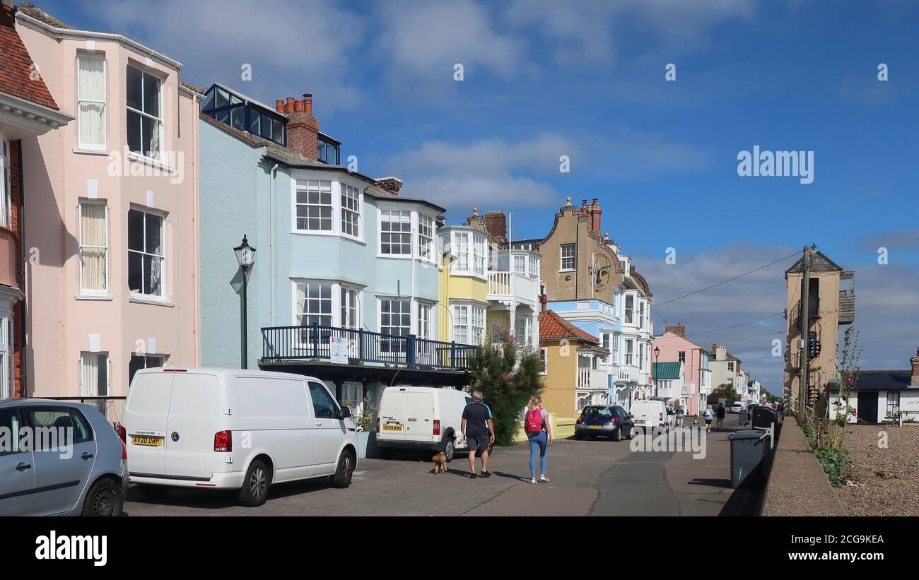 Aldeburgh, Suffolk, UK - 9 September 2020: Bright autumn day on the East Anglia coast. Pastel painted seafront houses. Stock Photo