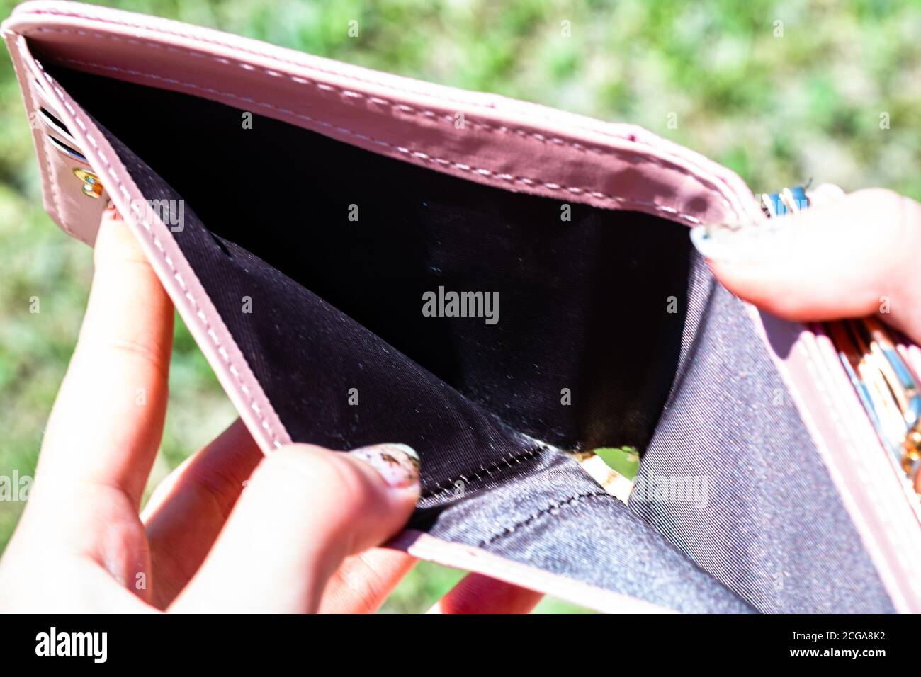 Hands holding and showing an empty wallet. Lack of money,  need of money low income because of unemployment and economic crisis. Stock Photo