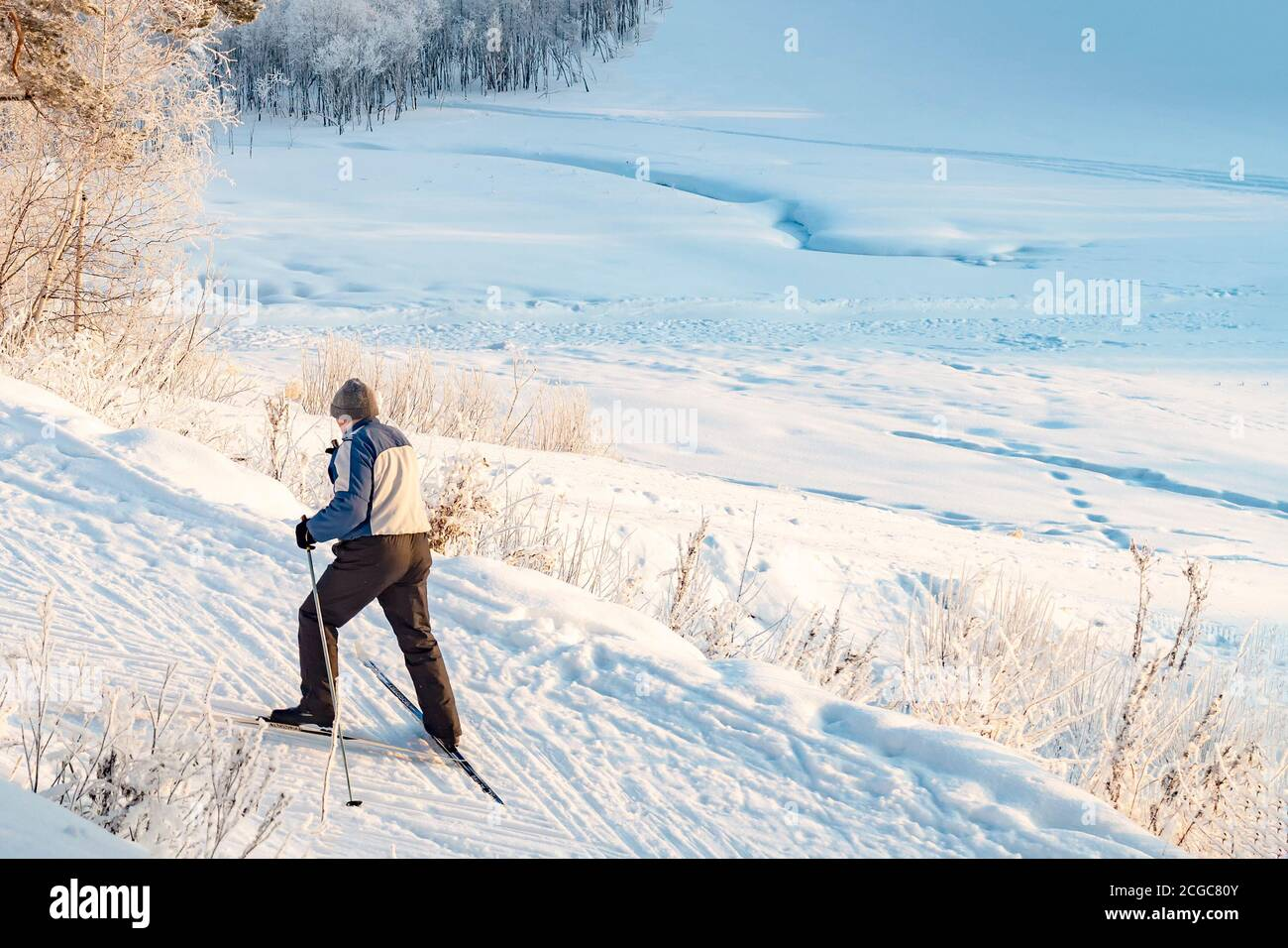Skier man moves uphill. View from above. New Stock Photo