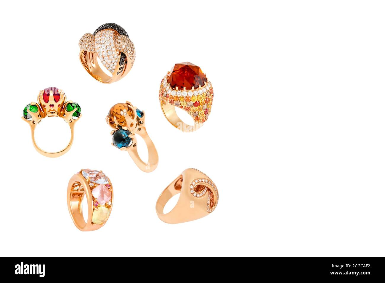 Golden diamond rings isolated on white background. Different rings with diamonds and precious color gemstones. Luxury jewelry, yellow gold, copyspace Stock Photo