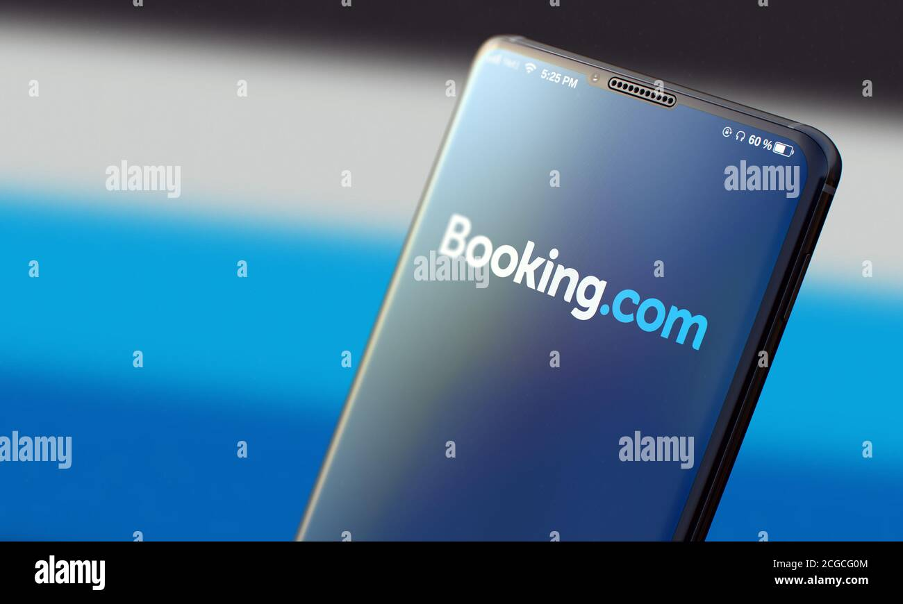 KYIV, UKRAINE-JUNE, 2020: Booking. Studio Shot of Smartphone with Booking Mobile Application on Blurred Back. Stock Photo