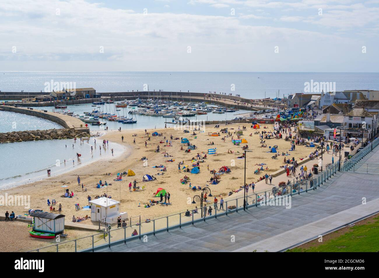 Lyme Regis, Dorset, UK. 10th Sep, 2020. UK Weather: There were plenty of people out and about enjoying the lovely warm September sunshine at the seaside resort of Lyme Regis ahead of the mini heatwave and 'Indian Summer' forecast over the weekend. Credit: Celia McMahon/Alamy Live News Stock Photo
