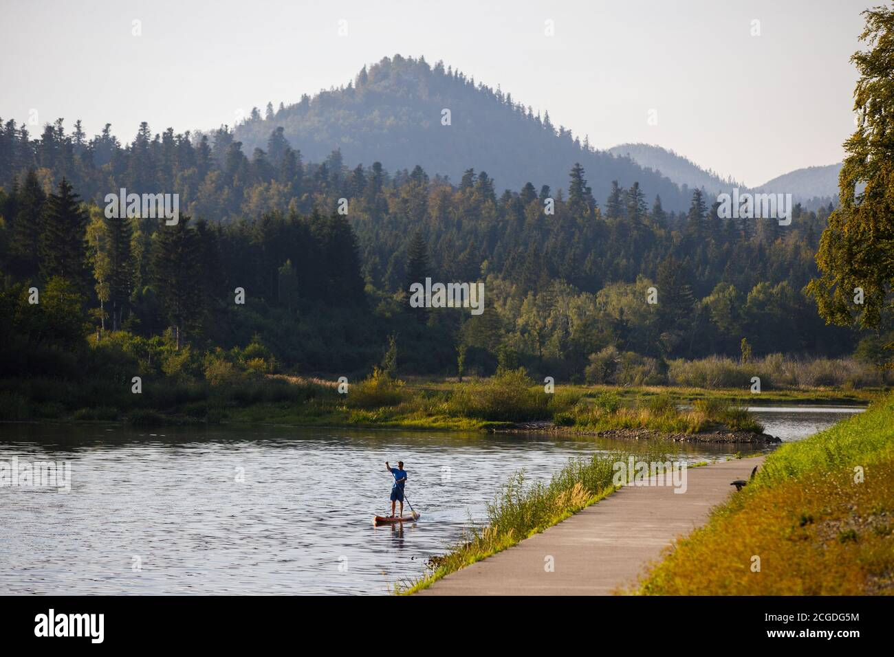 A man is seen on a standup paddleboard or SUP at a Bajer lake amid the coronavirus disease (COVID-19) outbreak in Fuzine, Croatia, September 10, 2020. REUTERS/Antonio Bronic Stock Photo