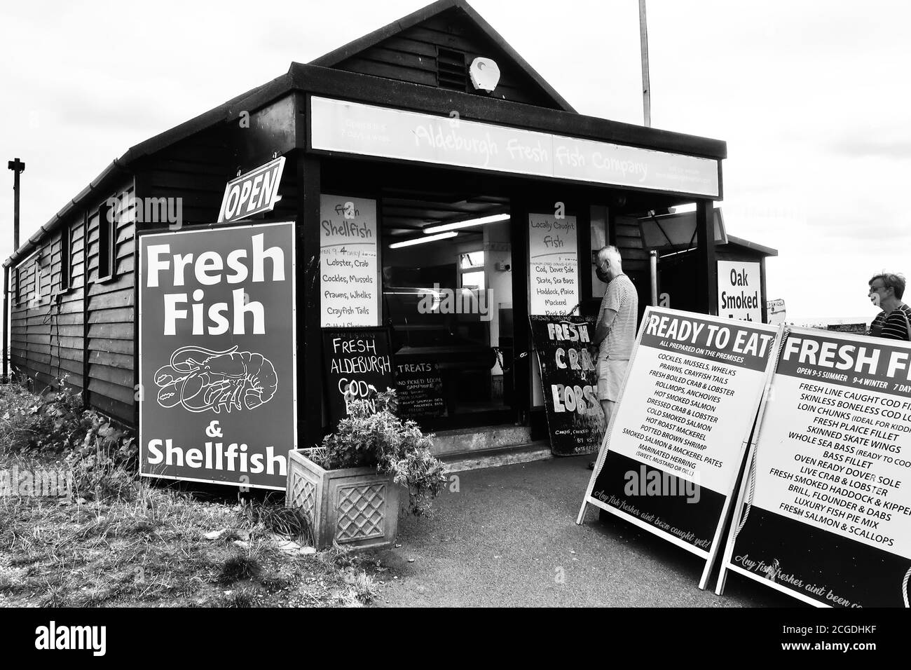 Aldeburgh, Suffolk, UK - 9 September 2020: Sunny autumn day on the East Anglia coast. Fresh fish seller shed on the beach. Stock Photo