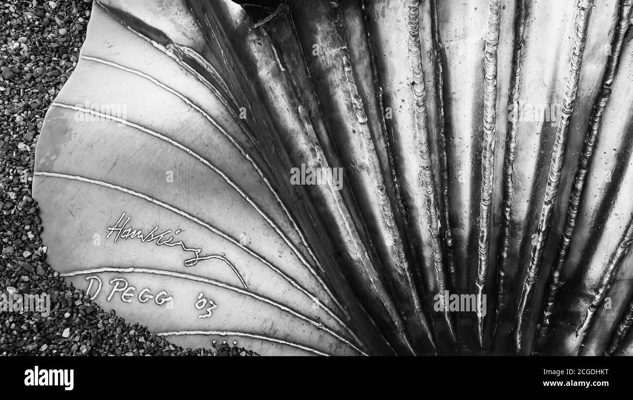Aldeburgh, Suffolk, UK - 9 September 2020: Art on the East Anglia coast. Signature detail on The Scallop by Maggi Hambling. North beach. Stock Photo