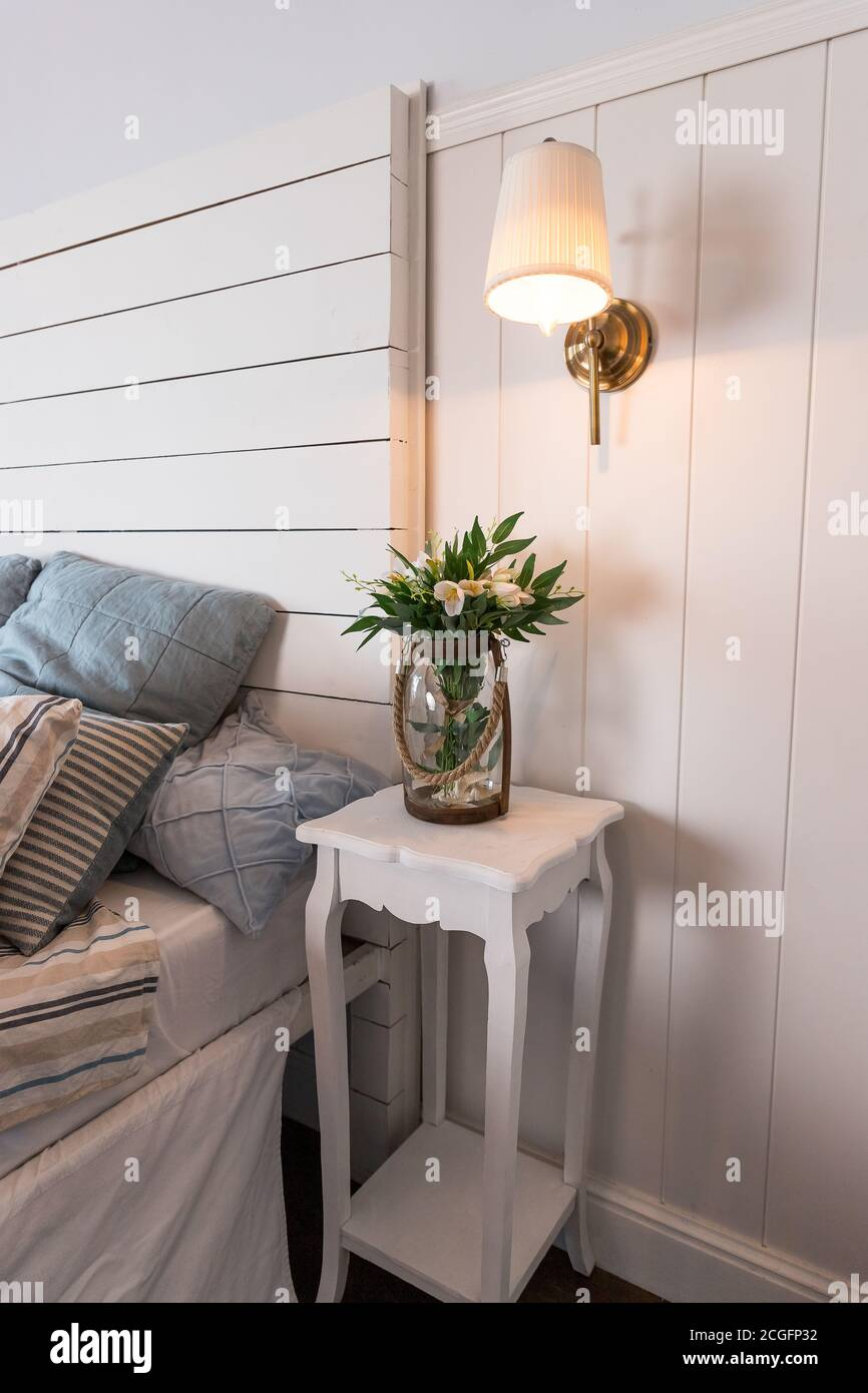 Bright And Comfortable Bedroom Interior Design In Scandinavian Style Flowers On Bedside Table Pillow On Bed Decoration Room Interior Burning Small Stock Photo Alamy