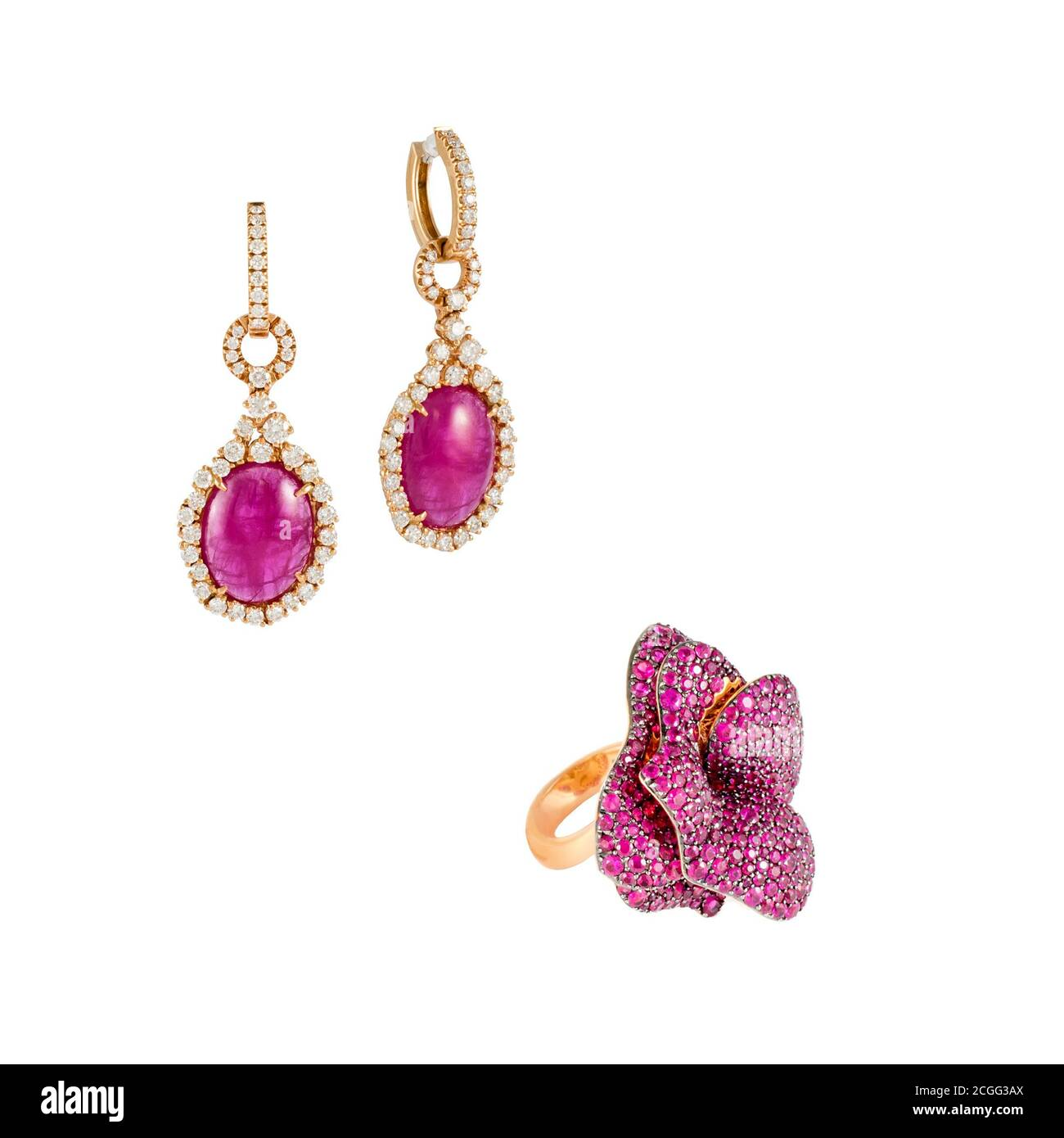 Pink tourmaline and sapphires jewelry ring and earrings in pink gold isolated on white background. Golden jewelery with diamonds, luxury jewelry. Stock Photo