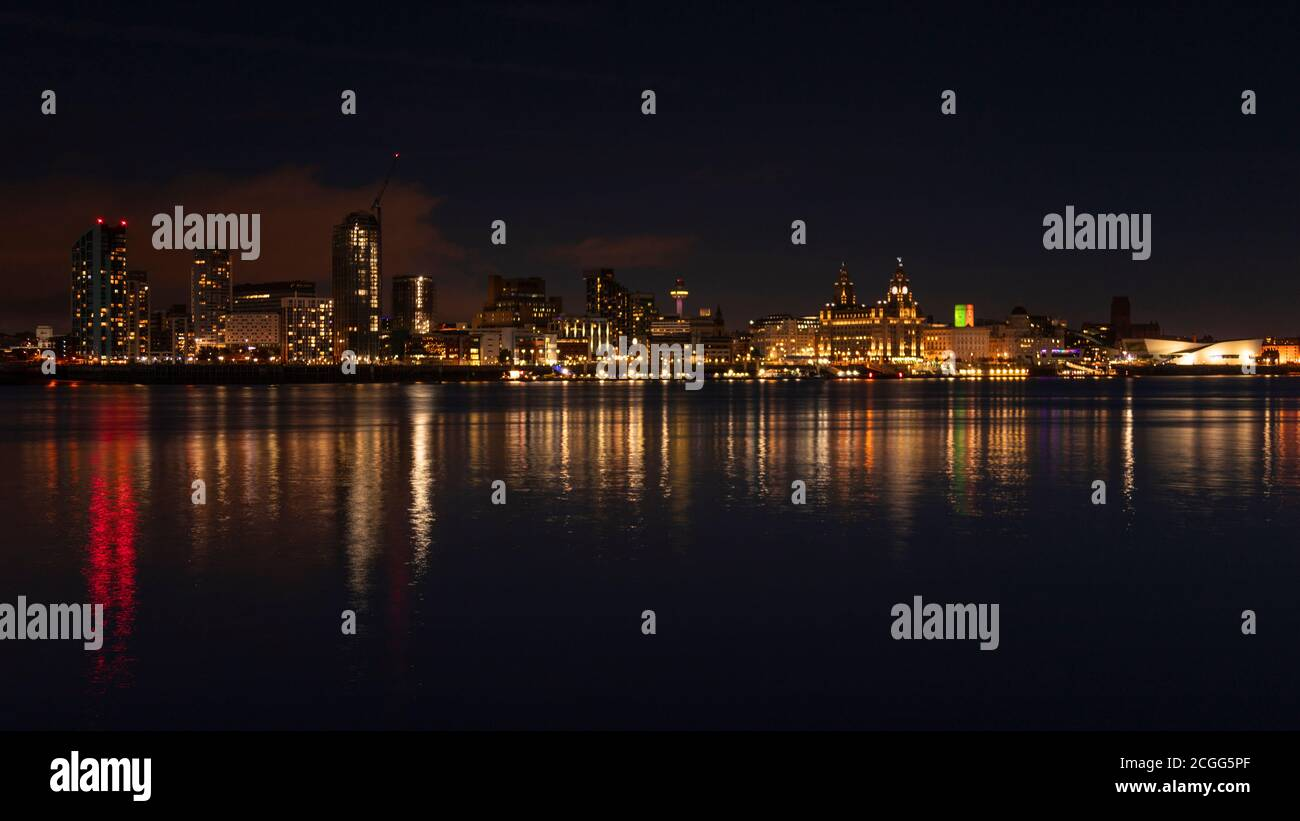Liverpool skyline and River Mersey at night, Merseyside, England Stock Photo