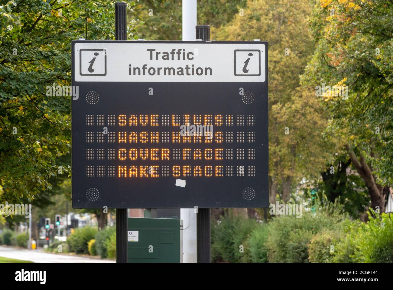 COVID-19 slogan message on traffic information matrix sign. Save lives, wash hands, cover face, make space, message. Southend on Sea, Essex, UK Stock Photo