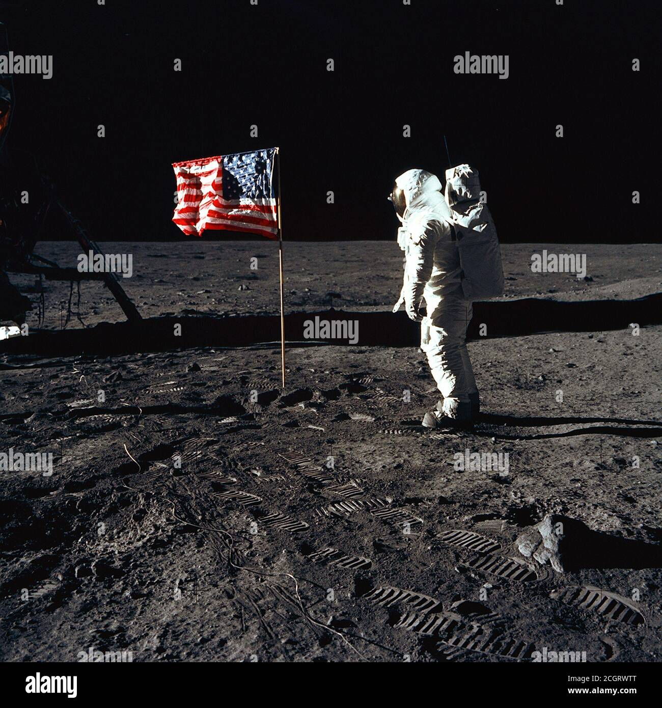 Buzz Aldrin and the U.S. Flag on the Moon 1969. Astronaut Buzz Aldrin, lunar module pilot of the first lunar landing mission, poses for a photograph beside the deployed United States flag during an Apollo 11 Extravehicular Activity (EVA) on the lunar surface. Stock Photo