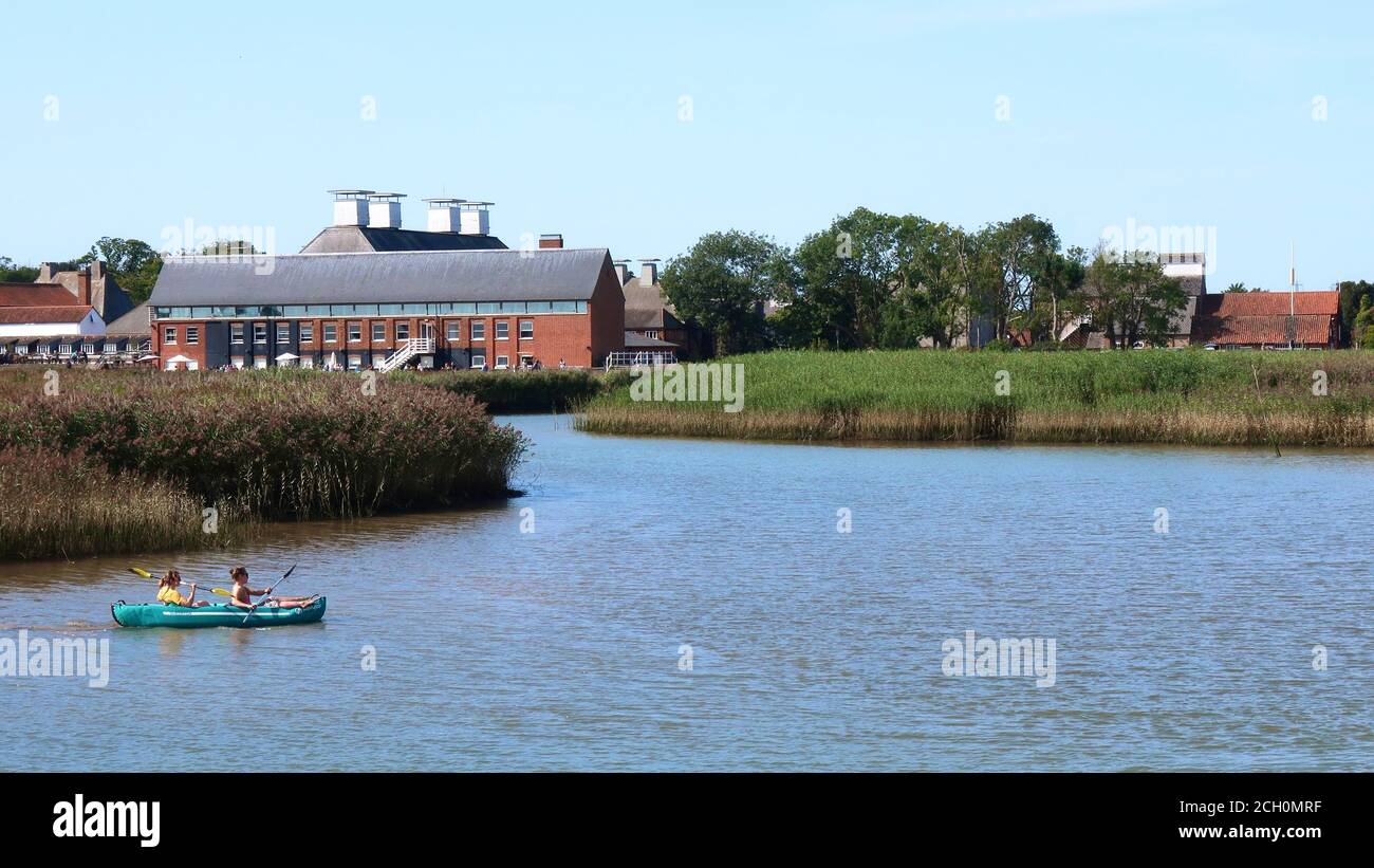 Snape, Suffolk, UK - 13 September 2020: Sunny Sunday autumn afternoon for two canoeists on River Alde at Snape Maltings. Stock Photo