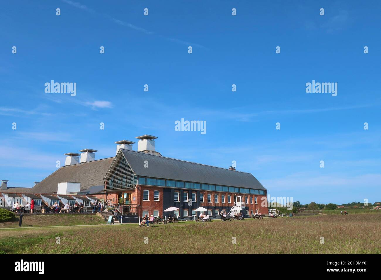 Snape, Suffolk, UK - 13 September 2020: Sunny Sunday autumn afternoon by the River Alde at Snape Maltings. Stock Photo