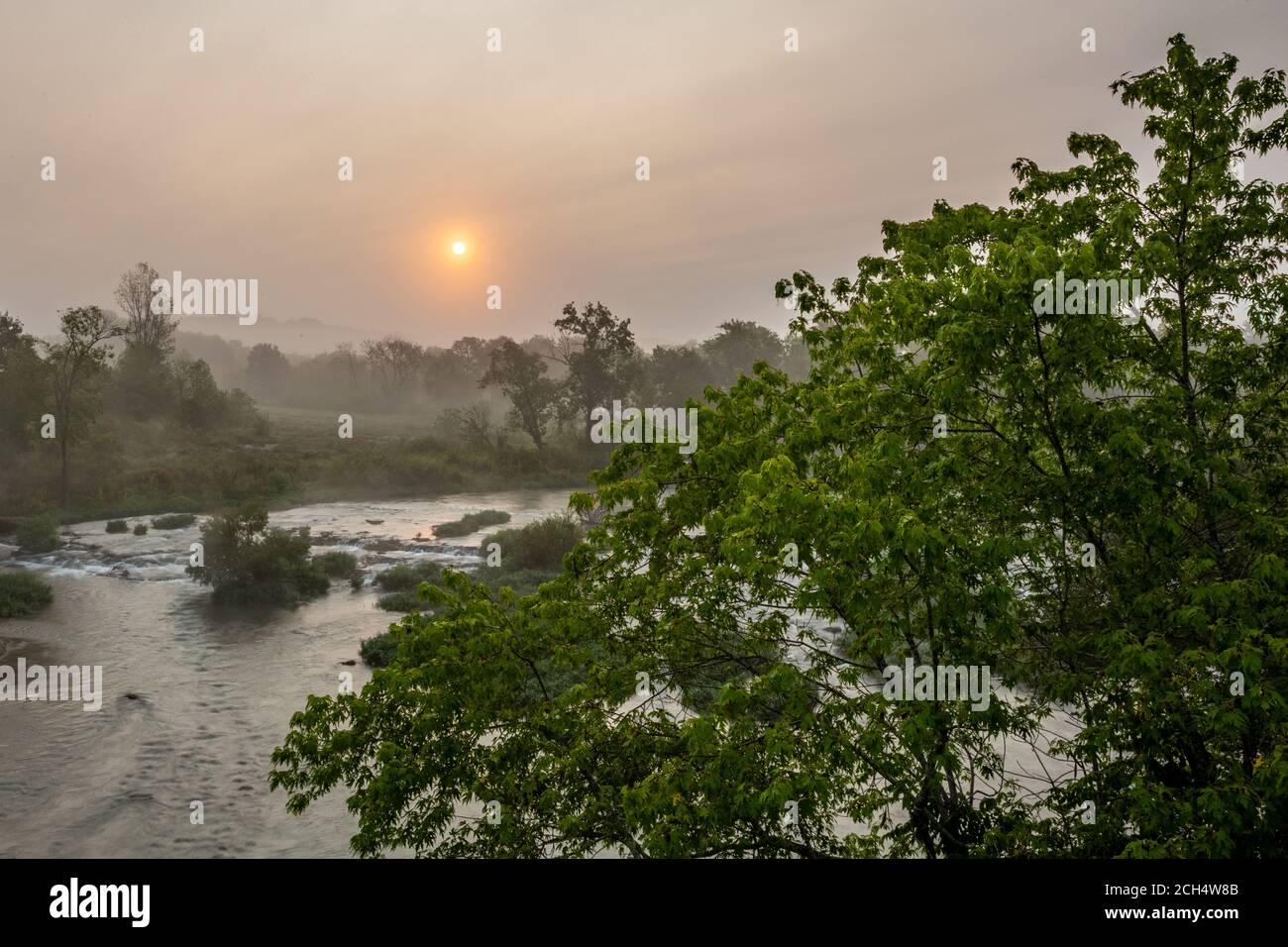 Foggy sunrise over Shoal Creek in Joplin, Missouri Stock Photo
