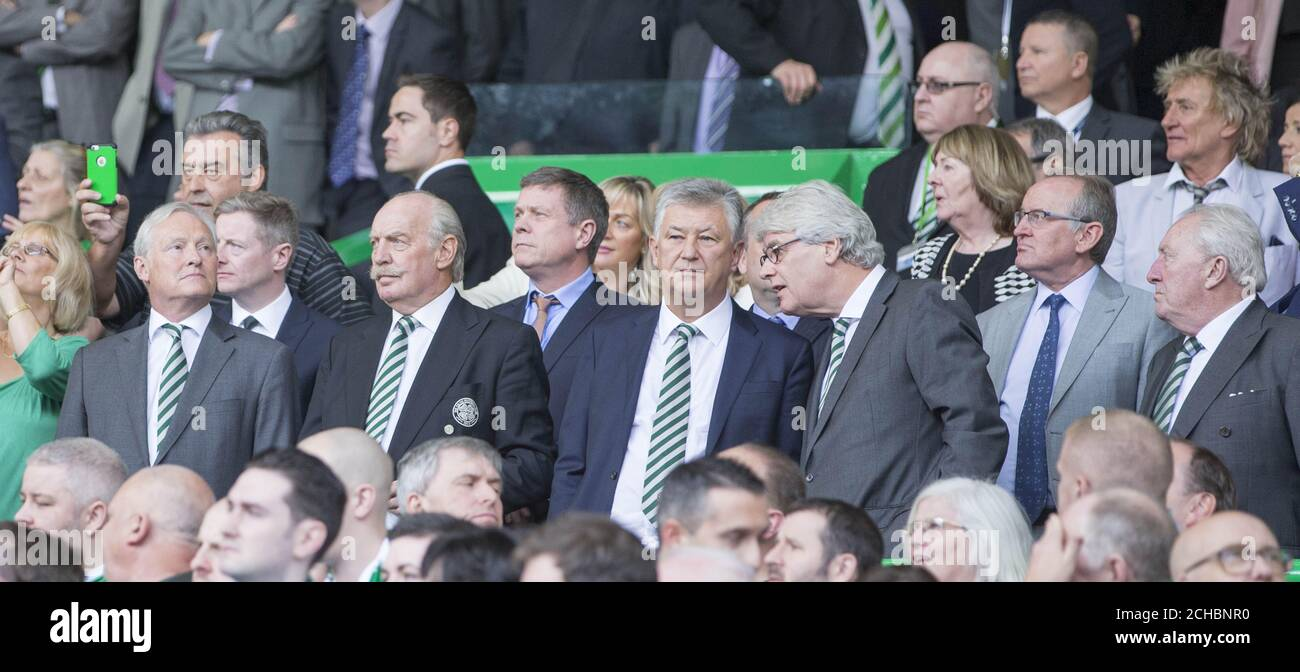 Celtic board chairman ian Bankier, Dermot Desmond and Peter Lawwell watched over by Rod Stewart (top right) during the Ladbrokes Scottish Premiership match at Celtic Park, Glasgow.  Stock Photo
