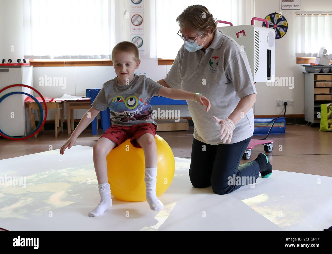 Embargoed to 0001 Monday June 22 Callum McMichael alongside Paediatric Physiotherapist Kath Brimlow as he takes part in 1:1 session supporting development of posture and movement skills at the Craighalbert Centre. Coronavirus adaptations have been installed at the Scottish Centre for Children with Motor Impairments, Craighalbert Centre, Cumbernauld, as Scotland continues gradually lifting coronavirus lockdown measures. Stock Photo
