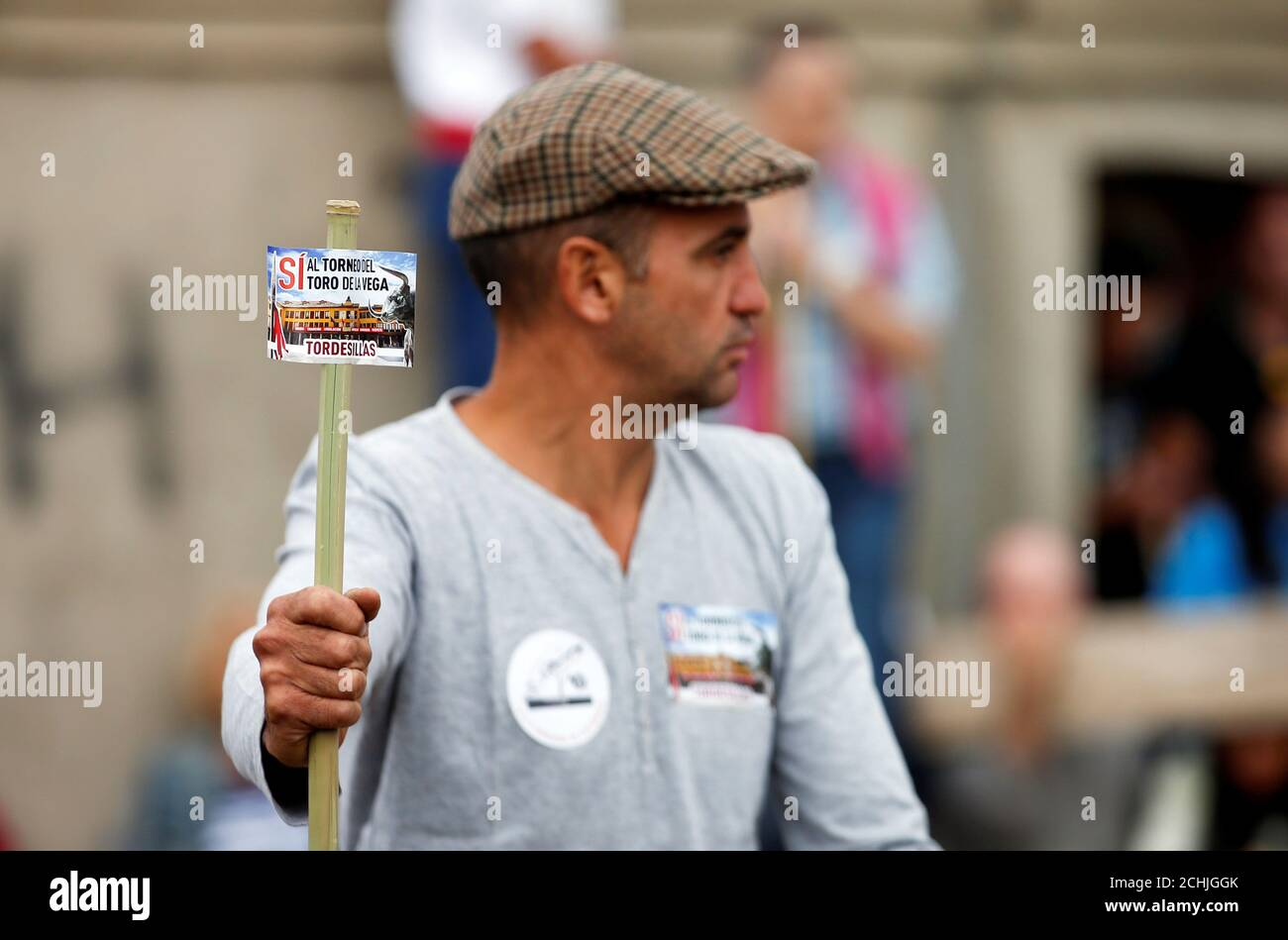 A Reveller On A Horse Holds A Stick Showing A Sticker Reading Yes To The Toro