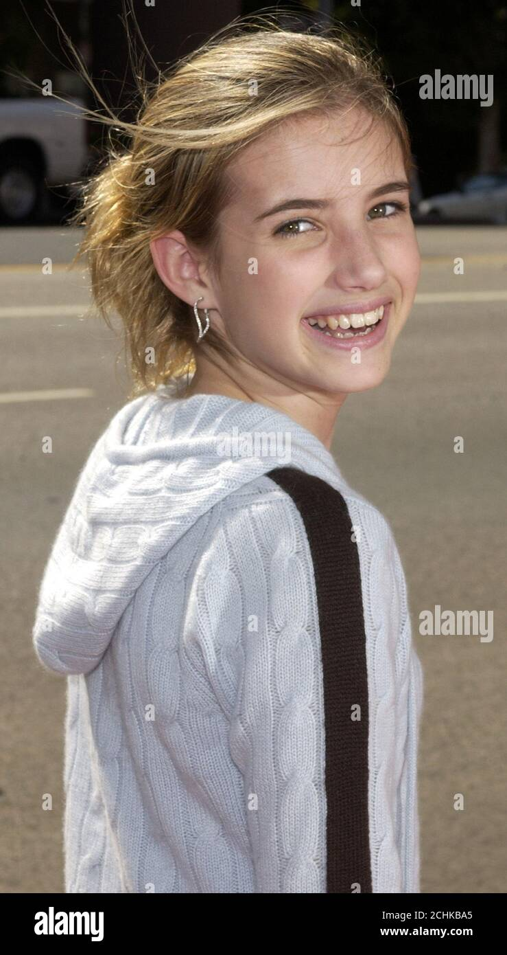 Emma Roberts A Cast Member In The Motion Picture Grand Champion Poses As She Arrives For