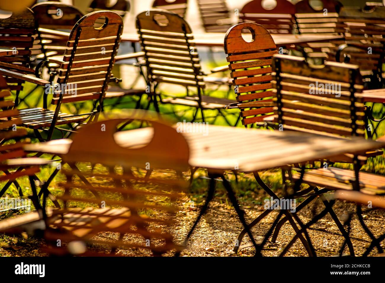 empty chairs and desks of a garden restaurant Stock Photo