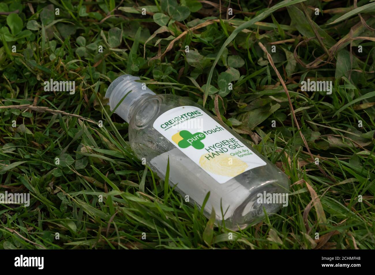 A discarded empty plastic bottle that originally contained hand sanitiser. Stock Photo