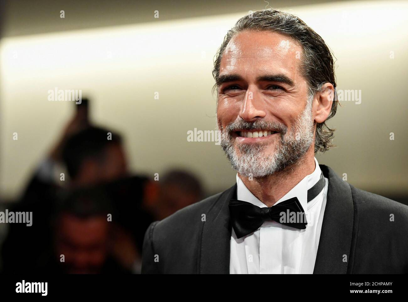 """The 76th Venice Film Festival -Screening of the film """"Waiting for the Barbarians"""" in competition- Red Carpet Arrivals - Venice, Italy, September 6, 2019- Sergio Muniz poses. REUTERS/Piroschka van de Wouw Stock Photo"""