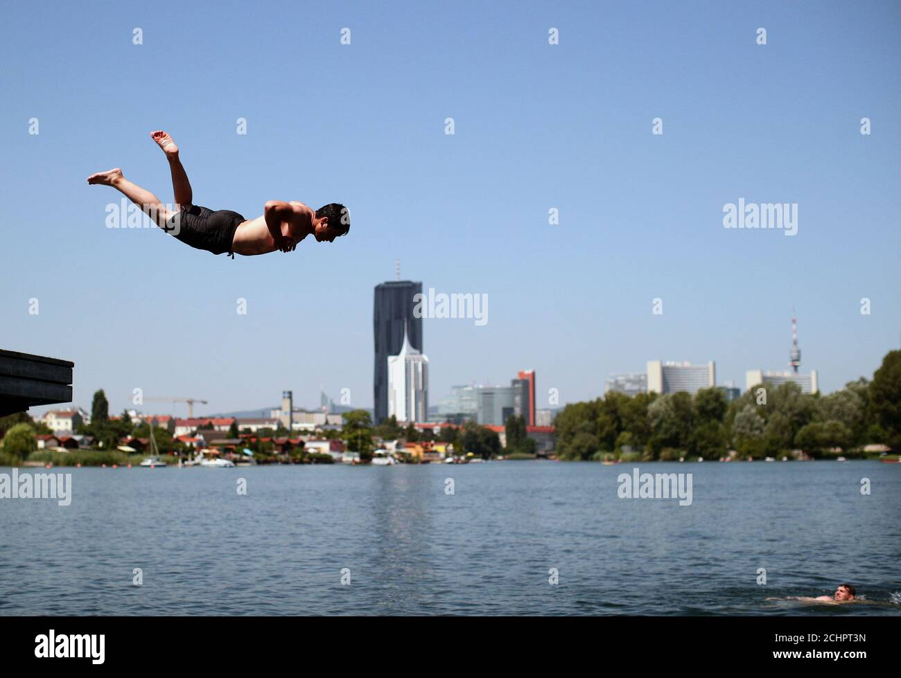 A Teenager Jumps Into Alte Donau An Abandoned Meander Of River Danube During A Heat Wave In Vienna Austria July 25 2019 Reuters Lisi Niesner Stock Photo Alamy