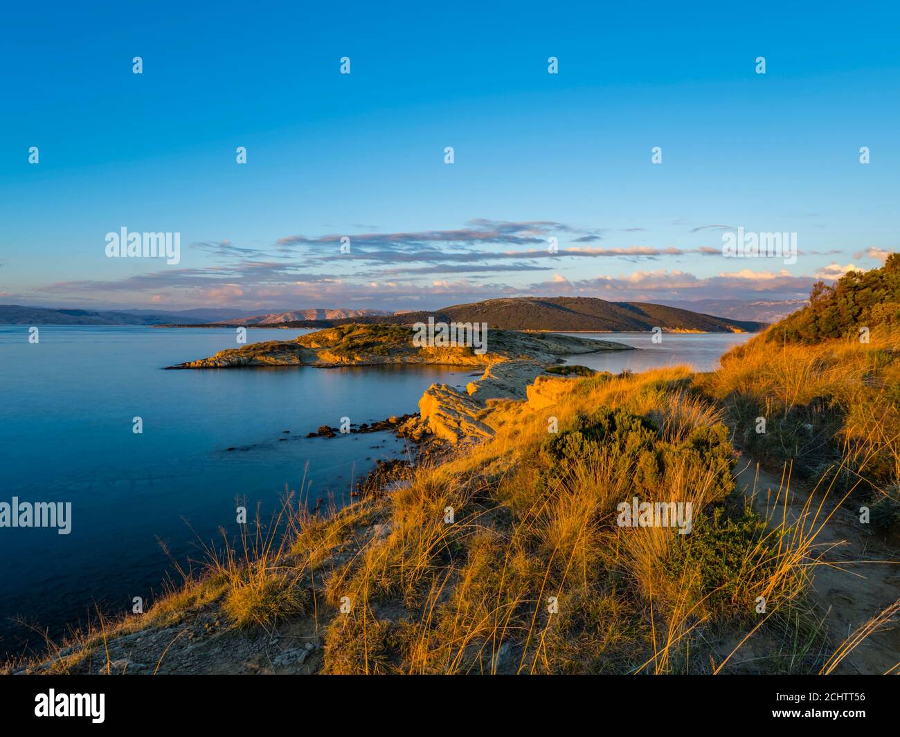 Long exposure smooth sea water surface picturesque peaceful tranquility panoramic atmospheric zen sunset warmth in Lopar on Rab island Croatia Europe Stock Photo