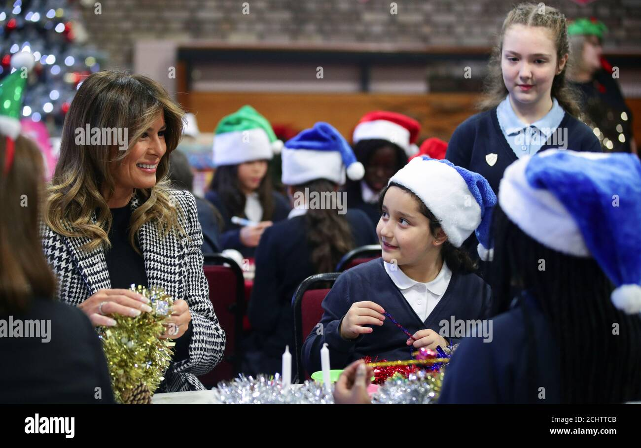 U.S. first lady Melania Trump prepares Christmas decorations with children as she visits the Salvation Army Clapton centre, as the NATO summit takes place in Watford, in London, Britain, December 4, 2019. REUTERS/Lisi Niesner Stock Photo