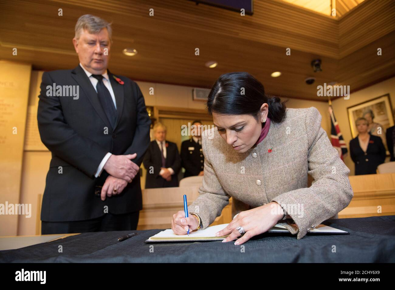 Home Secretary Priti Patel signs a book of condolence during a visit to Thurrock Council Offices in Grays, Britain, October 28, 2019. Stefan Rousseau/Pool via REUTERS Stock Photo