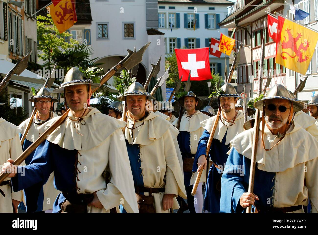 Medieval dressed participants carry halberds as they parade during the commemoration of the Battle of Sempach in the town of Sempach near Lucerne July 3, 2011. The battle was fought on July 9, 1386, a decisive victory won by the Swiss Confederation in its struggle with the Austrian Habsburgs.    REUTERS/Arnd Wiegmann (SWITZERLAND - Tags: ENTERTAINMENT) Stock Photo