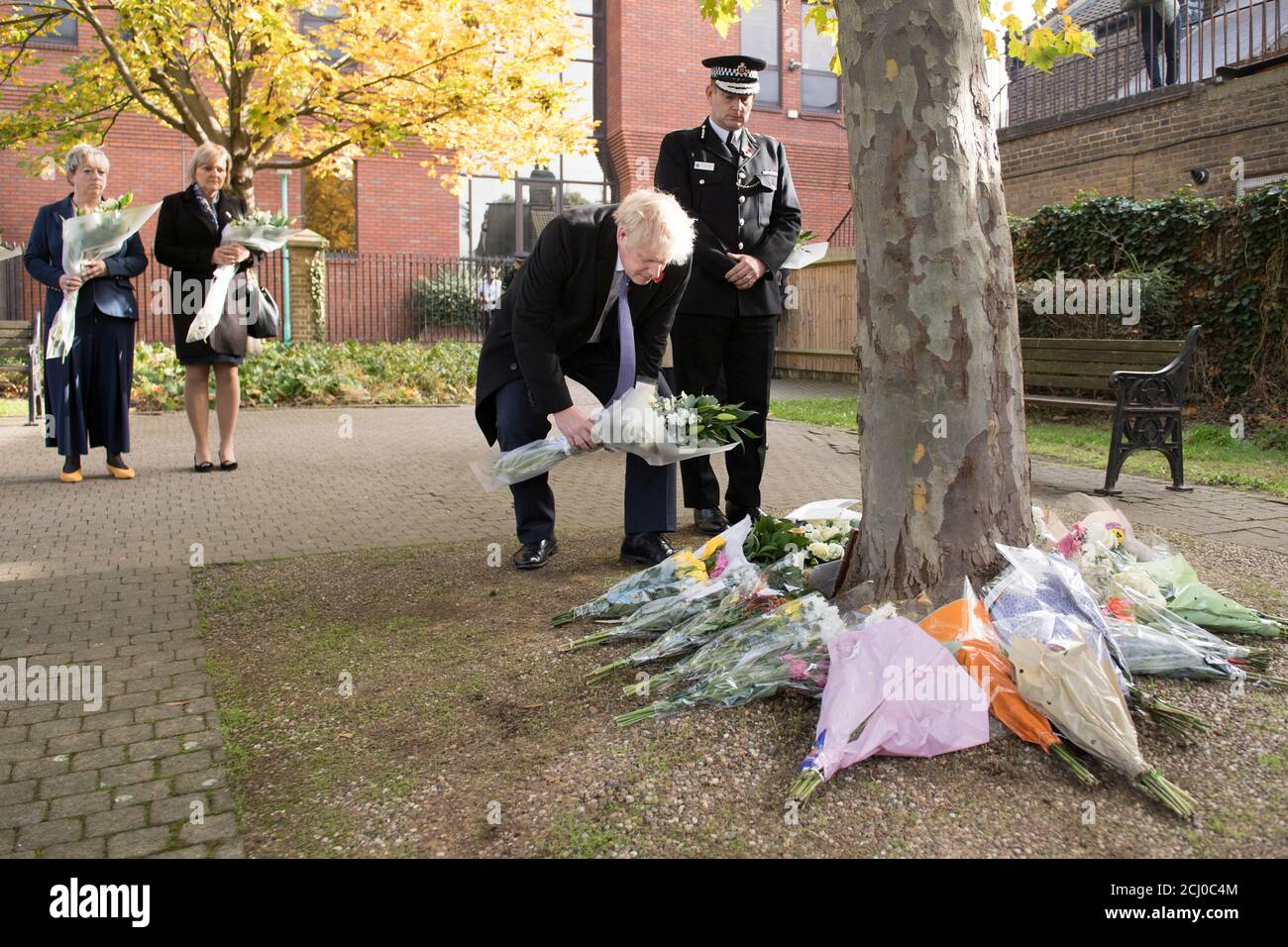 Prime Minister Boris Johnson stands with the Chief Constable of Essex Police, Ben-Julian Harrington, as he lays flowers during during a visit to Thurrock Council Offices in Grays, Britain, October 28, 2019. Stefan Rousseau/Pool via REUTERS Stock Photo