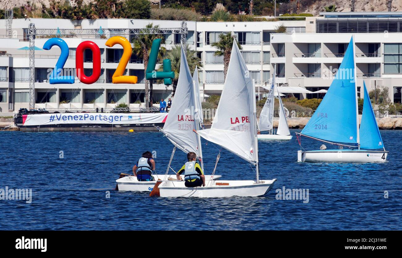 Children sail on boats at the site of the future Olympic Sailing ...